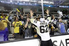 JUNE 12: Carl Hagelin #62 of the Pittsburgh Penguins celebrates with fans after their 3-1 victory to win the Stanley Cup against the San Jose Sharks in Game Six of the 2016 NHL Stanley Cup Final at SAP Center on June 12, 2016