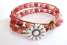 This leather wrap bracelet is made with 37 pink Agate beads on rich brown leather and a silver colored flower button. It will wrap around your wrist 2