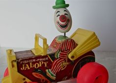 Fisher Price Jalopy Pull Toy (I still have mine in our basement. It's beat up but still recognizable.)