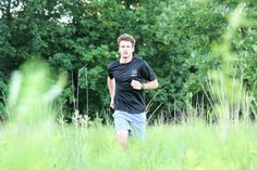 Runner in Meadow - Imagebase Cross Training, Jogging, Athlete, Competition, Workout, Mens Tops, Walking, Work Out, Running