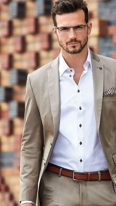 Simple business casual inspiration with a tan suit white button up shirt gingham pocket square brown leather belt  #businesscasual #summeroutfits #menswear #mensfashion #menstyle #suit #mensapparel