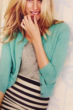 Black and white striped pencil skirt, grey shirt, and light blue cardigan.