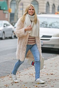 Fur enough: Heidi Klum kept out the cold for a stroll in New York City on Saturday, wearing a fashion forward pink fluffy coat which fell down to the knee