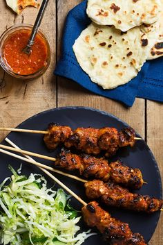 Learn how to make chef Curtis Stone's piri piri chicken skewers with cabbage and cucumber slaw.