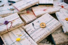 Use sheet music to wrap your favors. 10 Music Inspired Wedding Ideas on @intimatewedding Photo by @saralynnpaige #weddingmusic #musicalwedding #sheetmusicwrapping #music