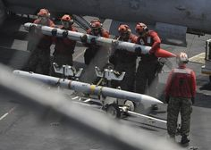 sailors lift a missile on the flight deck of the aircraft carrier USS Nimitz in the U. Fleet area of responsibility, Aug. The sailors, ordnancemen, are assigned to Marine Fighter Attack Squadron 323 Us Navy Aircraft, Navy Aircraft Carrier, Military Aircraft, Military Weapons, Military Life, Semper Fi Marines, Coast Gaurd, Uss America, Navy Carriers