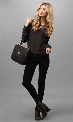One of our favorite go-to casual staples can instantly be dolled up just by pairing it with svelte black leggings and a pair of really great high-heeled ankle boots. Throw on a statement necklace to dress up this versatile piece even more. Such an indispensable wardrobe basic!