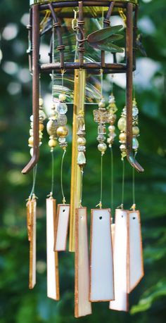 Elegant Wine Bottle Wind Chime - Tibet is made from Stained Glass, Gold/Green Wine Bottle, Up-cycled Metal Piece & Beads.  Unique Chime.