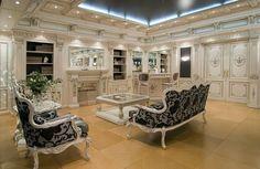Kolekcja meble klasyczne do salonu Georgia łączy neoklasycyzm z bogato ręcznie wykonanymi rzeźbami oraz precyzyjną intarsją wykonaną w drzewie pomarańczowym oraz sykomorowym w korzeniach drzewa orzechowego. Wyjątkowa jasność wnętrza zapewnia lakierowana wersja kolekcji wykonana z płatków złota oraz srebrna.