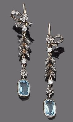 A pair of early 20th century aquamarine and diamond earrings. Each floral surmount with tied ribbon bow detail, suspending a foliate chain set throughout with rose, single and old brilliant-cut diamonds, terminating in a cushion-shaped aquamarine.