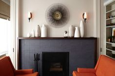 desire to inspire - desiretoinspire.net Love the way this fireplace is framed... And the tile is gorgeous