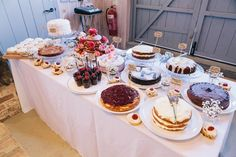 Dessert table rather than a cake.  Charming Outdoors Barn Wedding Cake Table http://www.brighton-photo.com/