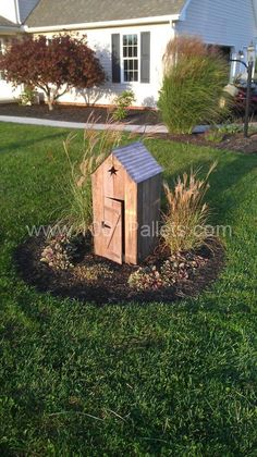 Mini outhouse to cover unsightly pipes in the yard... made from Pallet wood.
