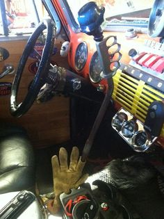 Ratrod interior with brass knuckles and a leather glove as a shifter boot