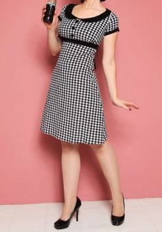I love this outfit.  Indie/Retro/Pinup and houndstooth all rolled into one.