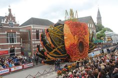 The massive floats are covered in flowers, which designers use to create these vibrant hues.