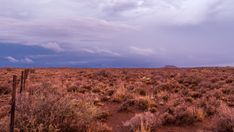 A static timelapse of a typical Karoo farm landscape in soft magenta and blue light with various cloud movements and a dramatic sky getting darker as the night falls. Windmill, Geology, Stock Footage, Magenta, Country Roads, Clouds, Sky, Mountains, Landscape