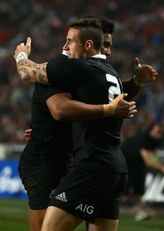 TJ Perenara of the All Blacks celebrates scoring a try with team mate Julian Savea