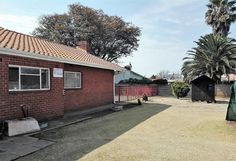 This promising house consists of 4 bedrooms that has tiled floors, built in cupboards and curtain rails. 2 Bathrooms, 1 with a basin and bath, 1 has a toilet and shower. Kitchen with washing machine and dish washing connections, ceiling fan and a scullery. Dining room to enjoy family dinners. TV room that includes an air-con, fireplace, TV port and curtain rails.Corridor. Outside toilet. Perimeter wall, alarm system, safety gate and outdoor beams for security features.   Patio to relax in… Outside Toilet, Tiled Floors, Built In Cupboards, Curtain Rails, Filling Station, Real Estate Agency, Alarm System, Garden Spaces, Shopping Center
