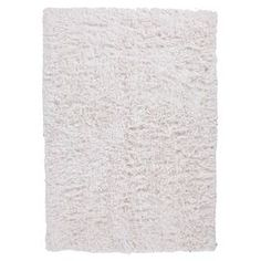 Hand-woven shag rug.  Product: RugConstruction Material: PolyesterColor: WhiteFeatures: Plush feelHand-wovenNote: Please be aware that actual colors may vary from those shown on your screen. Accent rugs may also not show the entire pattern that the corresponding area rugs have.