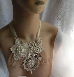 You can find more artistic expresions @    www.fashiondesignandlifestyle.blogspot.com/    This necklace include, vintage trims and fabrics as well as crocheted motifs, accented with swarovski crystals, and glass beads and pearls.  Photo from DAINTYCROCHETBYALY on Flickr.