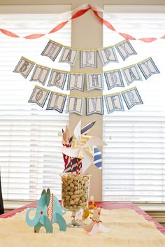 What a fun, but simple table centerpiece: peanuts in a vase with colorful pinwheels! #socialcircus