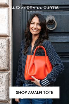 Inspired by lazy summers on the island of Capri and the magnificent views of the Amalfi coast. Made with our signature lightweight leather and minimal hardware, this bag is a great grab-and-go option whether you're running to catch a ferry for the weekend or on your way to the office. Choose between two sizes: midi for everyday use and maxi for when you need to carry a little bit more. Subscribe to our mailing list to get 10% off your first order: www.alexandradecurtis.com/join Italian Leather Handbags, Designer Leather Handbags, Denim Handbags, New Handbags, Orange Handbag, Best Purses, Stylish Outfits, Fall Outfits, Orange Fashion