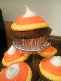 Cupcakes for Abbey's birthday - Devil's food + cream cheese icing, swirled to look like a candy corn.