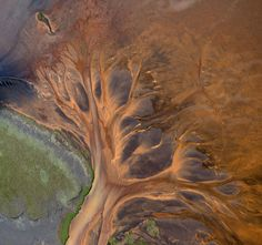 Andre Ermolaev is a photographer from Moscow, Russia (featured previously). In an ongoing series of aerial photos, Andre captures Iceland's incredible landscape like you've never seen. Many of his images focus on capturing glacial rivers flowing through Iceland's volcanic areas and the patterns and colours that emerge from the resulting flow.