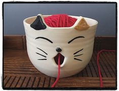 Please check my cute calico cat yarn/knitting bowl. This yarn bowl has a open mouth and a curvy J shaped slot tail to guide your yarn. This bowl would be a great gift for the knitter who LOVES or COLLECTS cat! They will play with your yarn whenever you are knitting.  Made of high fire cone 6 stoneware clay and lead free, food safe glaze used.  Because it is food safe, you can use this bowl for your fruit or bread.  food safe, microwave safe and hand wash recommended.  Very unique gift item…