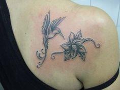 Feminine Hummingbird Tattoo | ... Humming Bird Tattoo Shoulder Tattoo Girl With Swallow Tattoo On Her