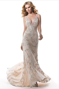 An incredible deep-V wedding gown by Maggie Sottero. Oh so very glam and reminiscent of the Great Gatsby!