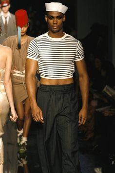 """Gaultier continues: """"When I started in fashion, I had already adopted the sailor-striped sweater as my uniform; that way, I wouldn't have to drive myself crazy trying to figure out what to wear. I've worked variations of stripes and the sailor uniform into each of my haute couture and prêt-à-porter women's collections before designing my first men's collection. Then at one time, I was going to London pretty often, where men were dressing in a sexier way. I wondered what erotic clothes for…"""