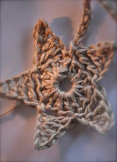Patina Moon: Star Garland.  Easy instructions.  I wonder what these would look like in jute twine?