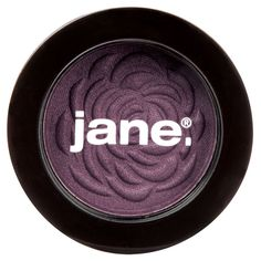 Jane Cosmetics Eye Shadow, Cosmo Shimmer, 288 Ounce. Cosmo is a smoky black with purple shimmer. Experiment and play with an array of shimmery shades. after all, Jane believes that confidence comes in many colors!. Made with rich pigments for intense color. Soft, luxurious texture feels smooth on skin. Embossed with Jane's signature blooms as a symbol to empower and inspire social good.