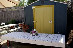 Shed– looks like an inexpensive stock type shed. Made very cute with paint....hmmmm.
