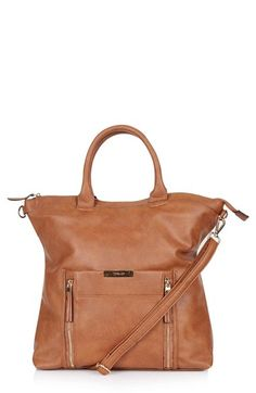 Free shipping and returns on Topshop Faux Leather Bag at Nordstrom.com. Crackling faux leather in a rich tan shade fashions this roomy bag outfitted with a durable handle and detachable crossbody strap for on-the-go functionality.