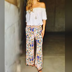 "Yes Please Floral Print Bottoms! Love these!! Pair up with an off the shoulder tee or cute strapy top! Super comfortable & lightweight! Colors are Orange/Ivory | Made in USA | Wide Leg | 95% Polyester | 5% Spandex **Measurements on a Small L: 40"" W: 11.5"" 
