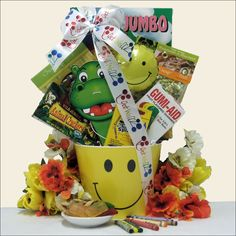 Perfect for wishing a sick child a speedy recovery, this kids gourmet gift basket is filled with fun activities and delicious snacks. All these thoughtful items are displayed in a happy face yellow pail and topped off with a Get Well ribbon.
