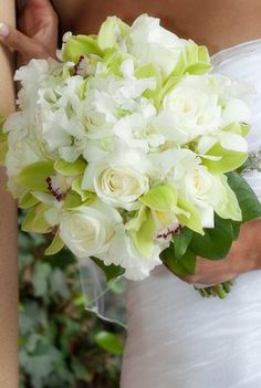 A white bridal bouquet is classic and elegant.  Adding a bit of green makes the white even more spectacular.  This bouquet includes hydrangea, sweet peas, dendrobium orchids, cymbidium orchids and beautiful roses.