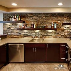 An earthy stone wall and a few floating shelves, and your basement just achieved pro entertainer status! #DIY #Design