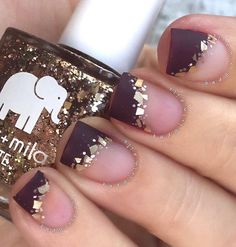 Try a bit of fun with the classic style by doing this French-tip inspired nail art design. Matte chocolate brown on the tips and add some flakes of gold along the lines.