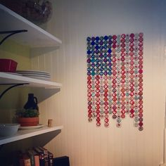 Bottle cap flag!!! Easy to do with glue gun and a piece of bead board. I love our flag!