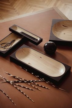 """The """"Cavetto"""" table trays were designed by Klemens Schillinger in 2020. The minimal pieces in black lacquered pine are produced by the Austrian furniture label """"One For Hundred"""". Due to the different color and grain of the wood, each """"Cavetto"""" table tray is a unique piece – not only for your home office but also for keys, jewelry and a lot more. Available in our online shop. Home office decoration   desk organization   sustainable home decor #diesellerie"""