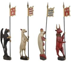 The Dacre Beasts, made in England, 1507-25. These heraldic sculptures were made for Lord Thomas Dacre, and were displayed in the Hall at Naworth Castle. The animals stand over 6 ft tall (over 11ft with the banners), and were carved from a single large oak. Following a fire at the castle in the mid-nineteenth-century, the sculptures were repainted and the present staves and banners added.