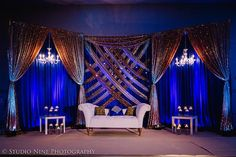 Royal blue and gold reception backdrop Wedding Draping, Wedding Reception Backdrop, Wedding Stage, Navy Blue And Gold Wedding, Royal Blue And Gold, Gold Backdrop, Floral Backdrop, Indian Wedding Receptions, Wedding Venues