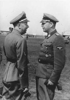 Obergruppenführer Hans-Adolf Prützmann (right) meets with Reichsführer-SS Heinrich Himmler, during Himmler's visit of the 5th SS Panzer Division Wiking in Ukraine, September 1942.