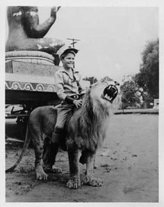 Circus Boy riding a lion he had a tv show.I believe that is Mickey Dolenz.
