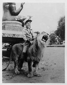 Circus Boy riding a lion
