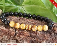 Hey, I found this really awesome Etsy listing at https://www.etsy.com/listing/263469205/mens-protection-bracelet-tigereyes